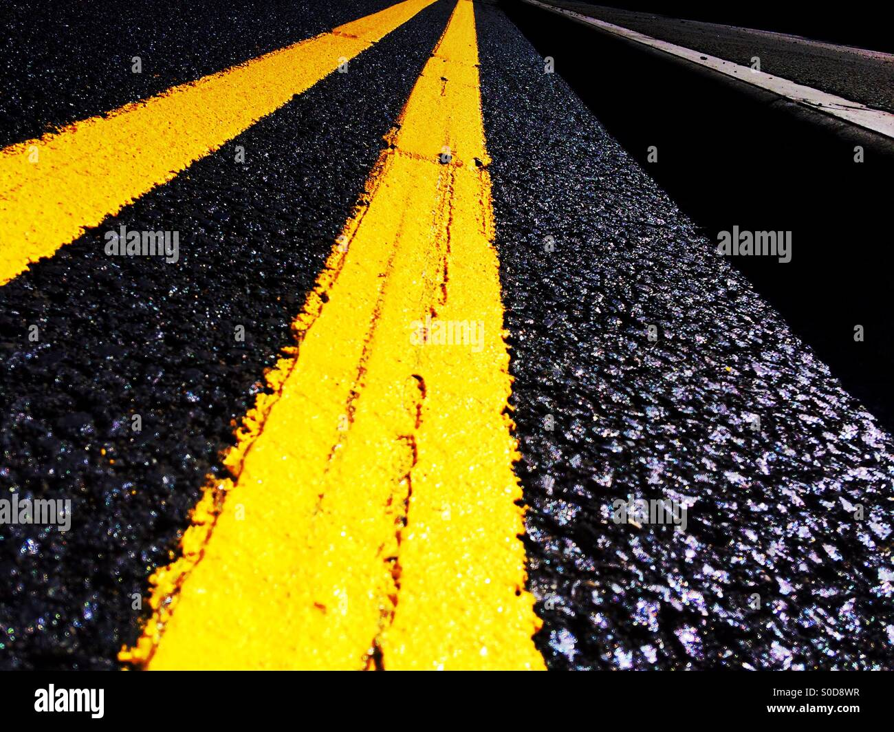 No Parking double yellow lines on a Tarmac road - Stock Image