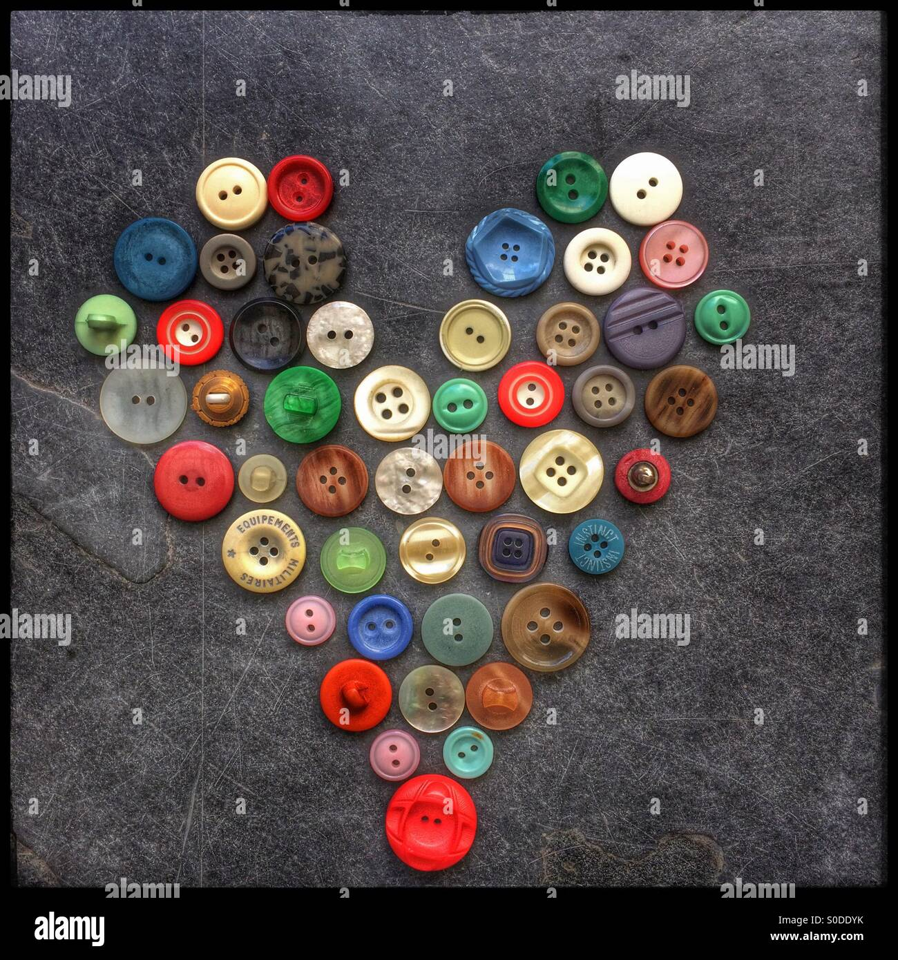 Heart shape made of buttons. - Stock Image