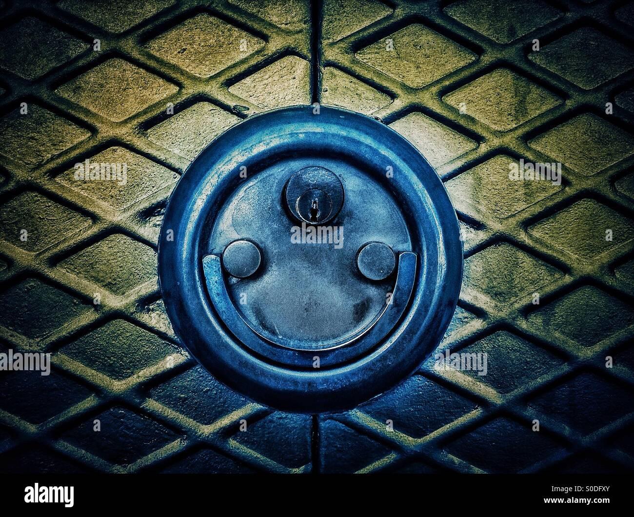 Door lock padlock smiling. Faces in objectsStock Photo