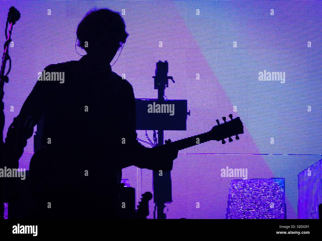 Silhouette of Tim Carter of Kasabian at Brixton Academy 4th December 2014. Stock Photo