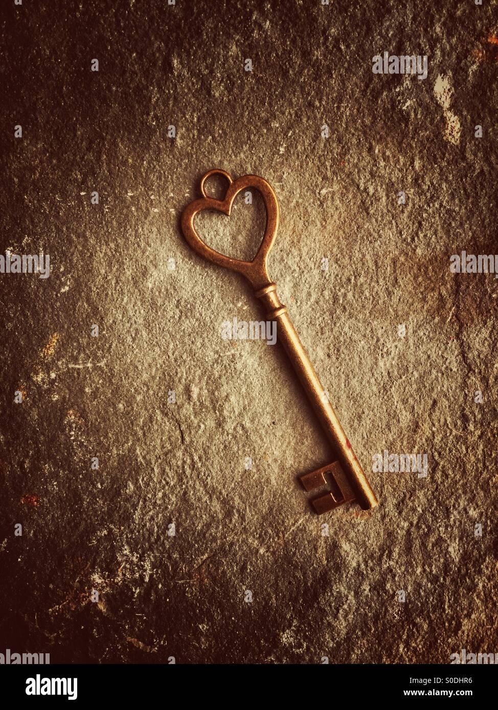 Heart shaped key - Stock Image