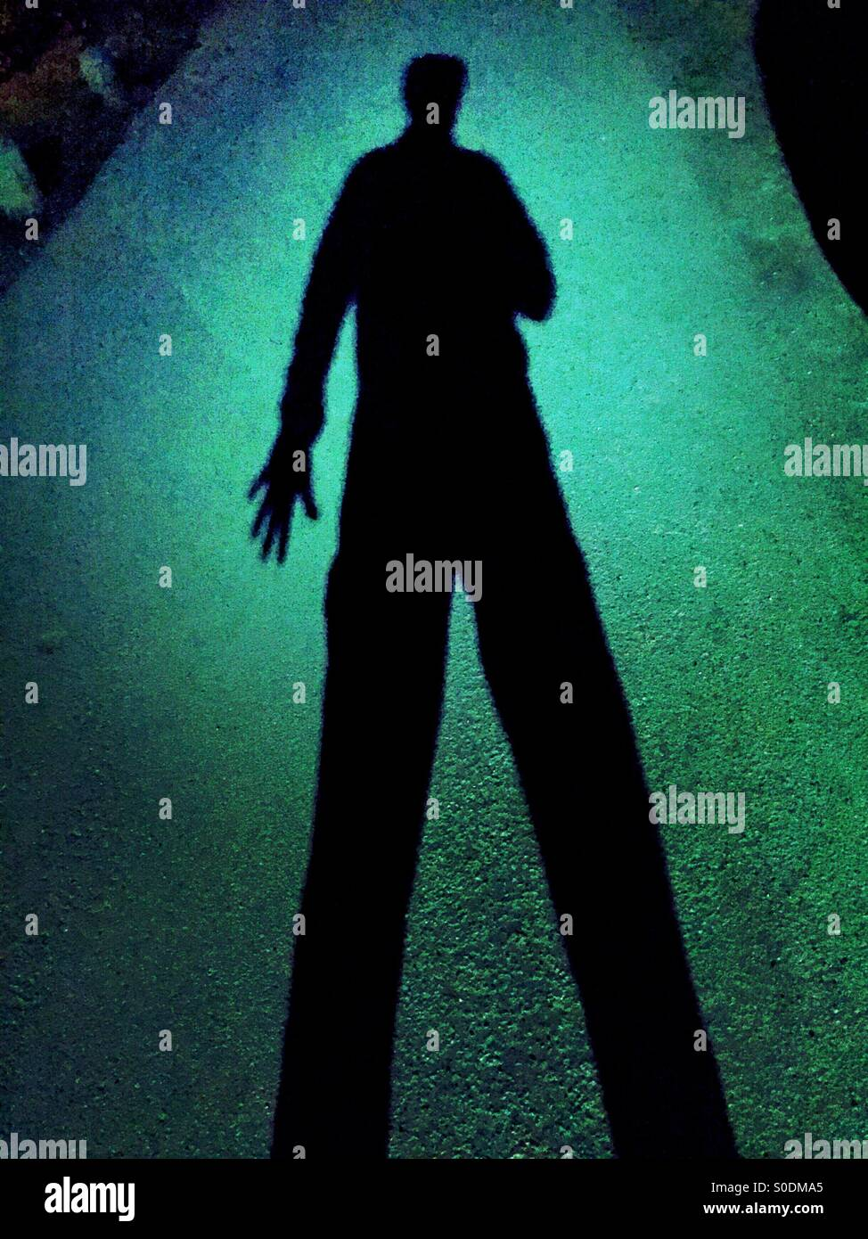 Gloomy shadow of a one armed man - Stock Image