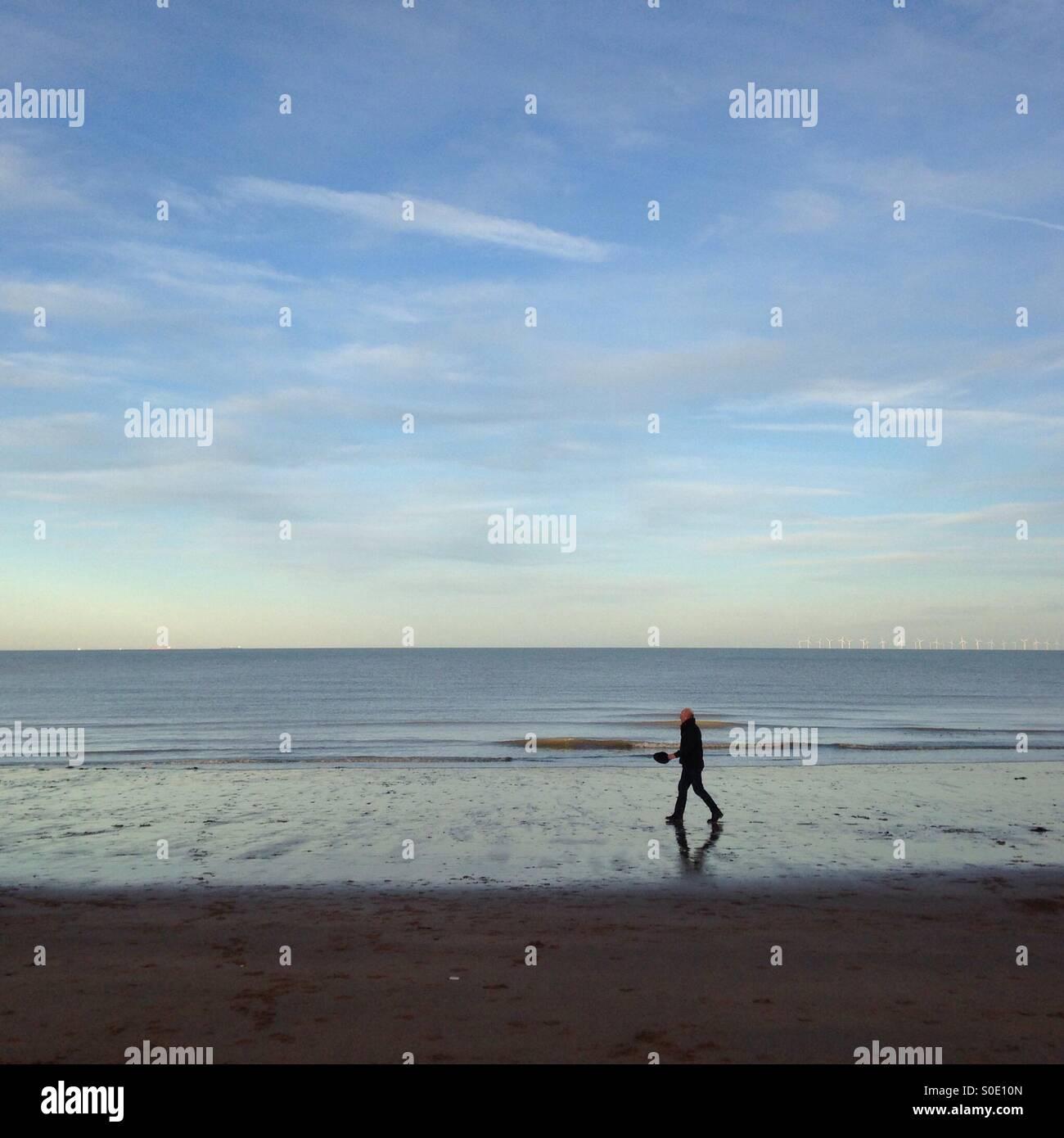 Walking on the beach - Stock Image