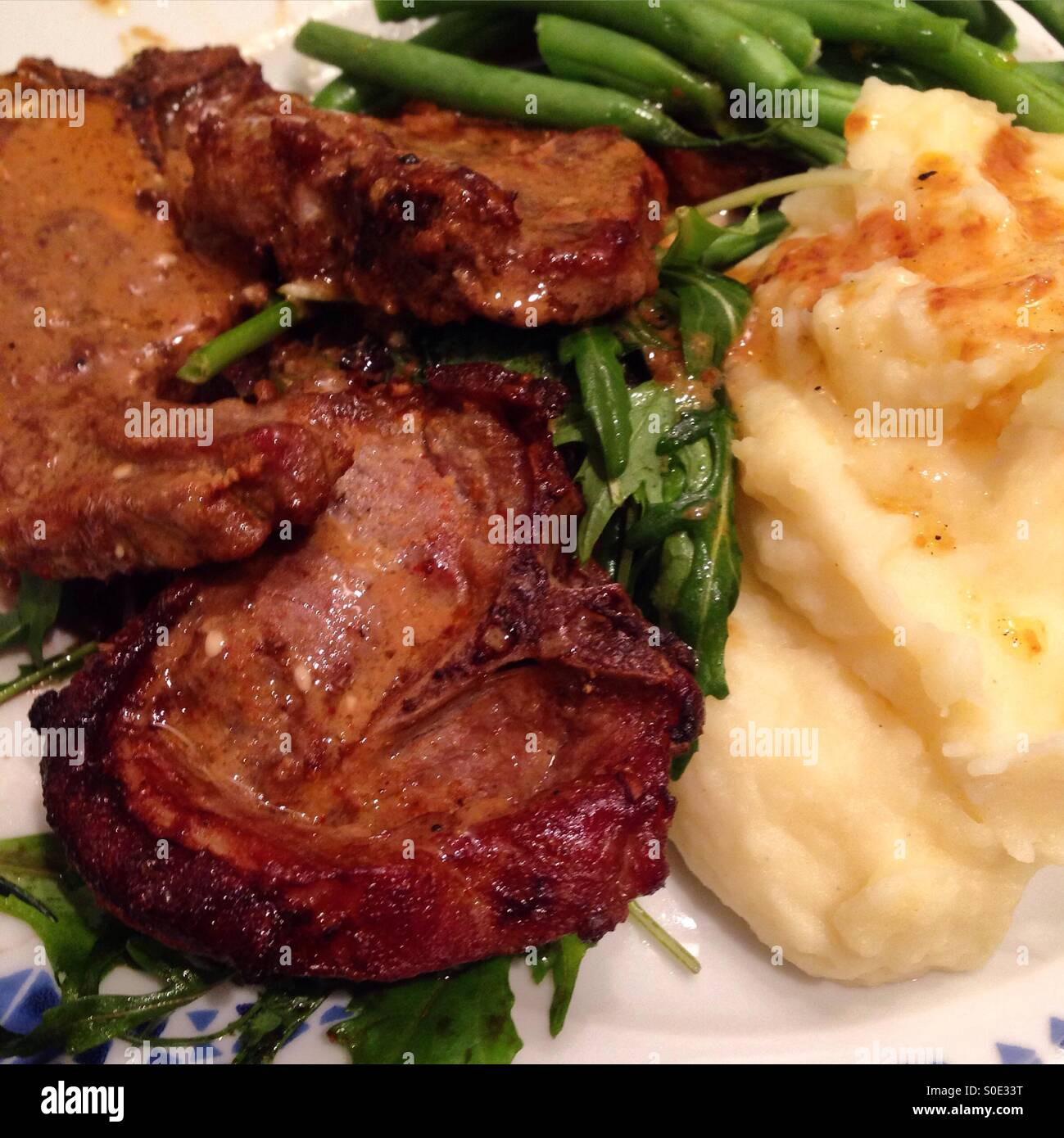 Pork chops, mash potato, green beans - Stock Image