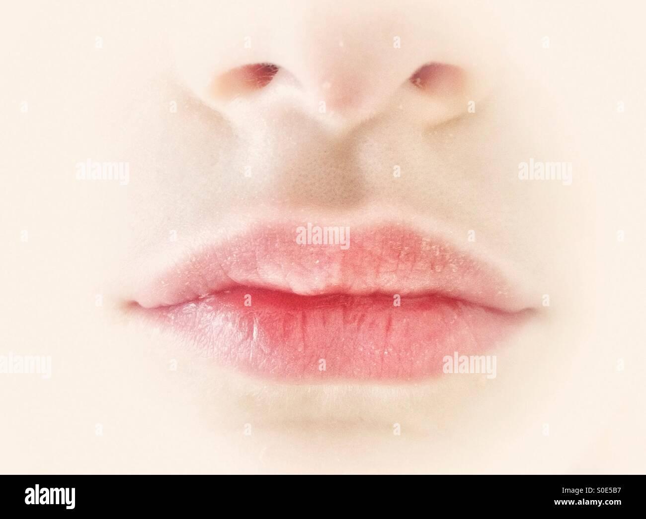 Lips of young girl - Stock Image