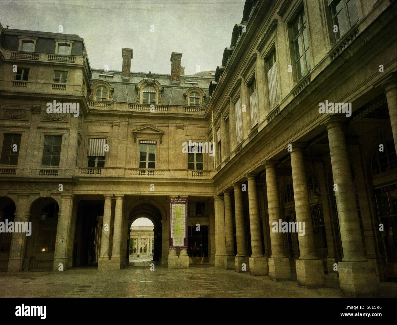 View of entrance to the galleries of the Place du Palais-Royal in Paris, France, with colossal pilasters of compositeStock Photo