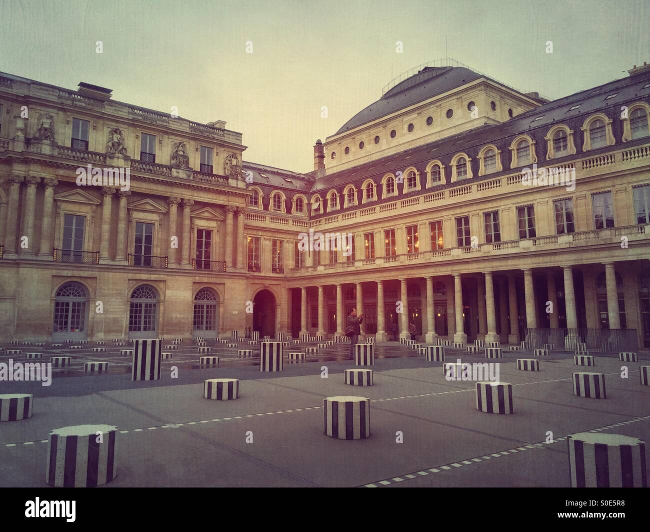 View of main courtyard at Place du Palais-Royal in Paris, France. Les Deux Plateaux installation by Daniel Buren Stock Photo