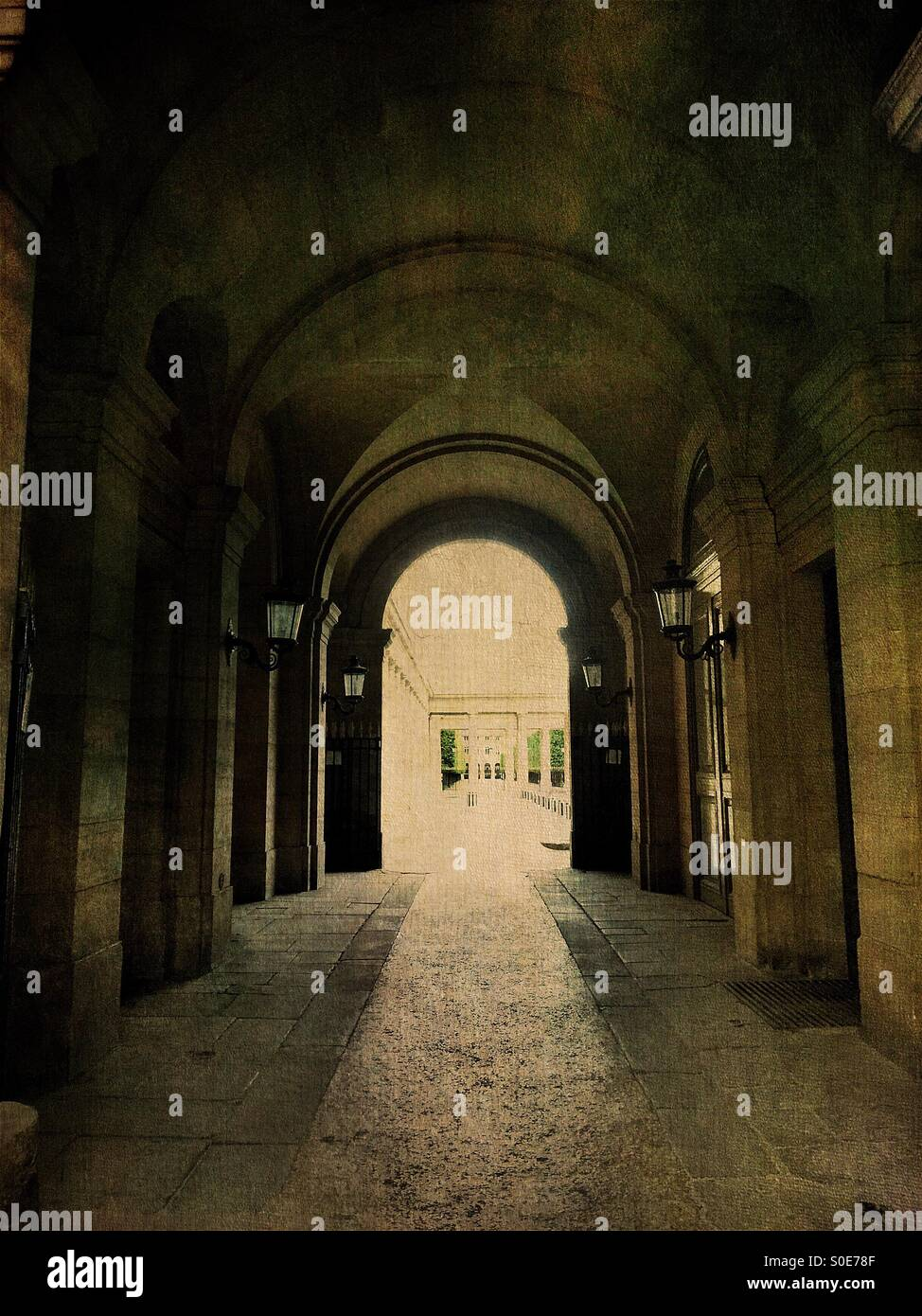 Arcade view of entrance to the galleries of the Place du Palais-Royal in the historic centre of Paris, France. Antique, Stock Photo
