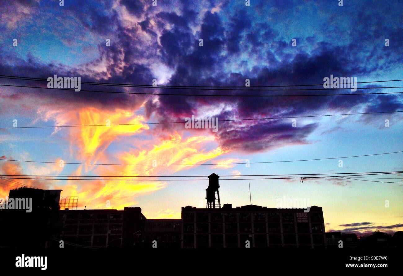 Sunset with magenta and gold clouds. - Stock Image