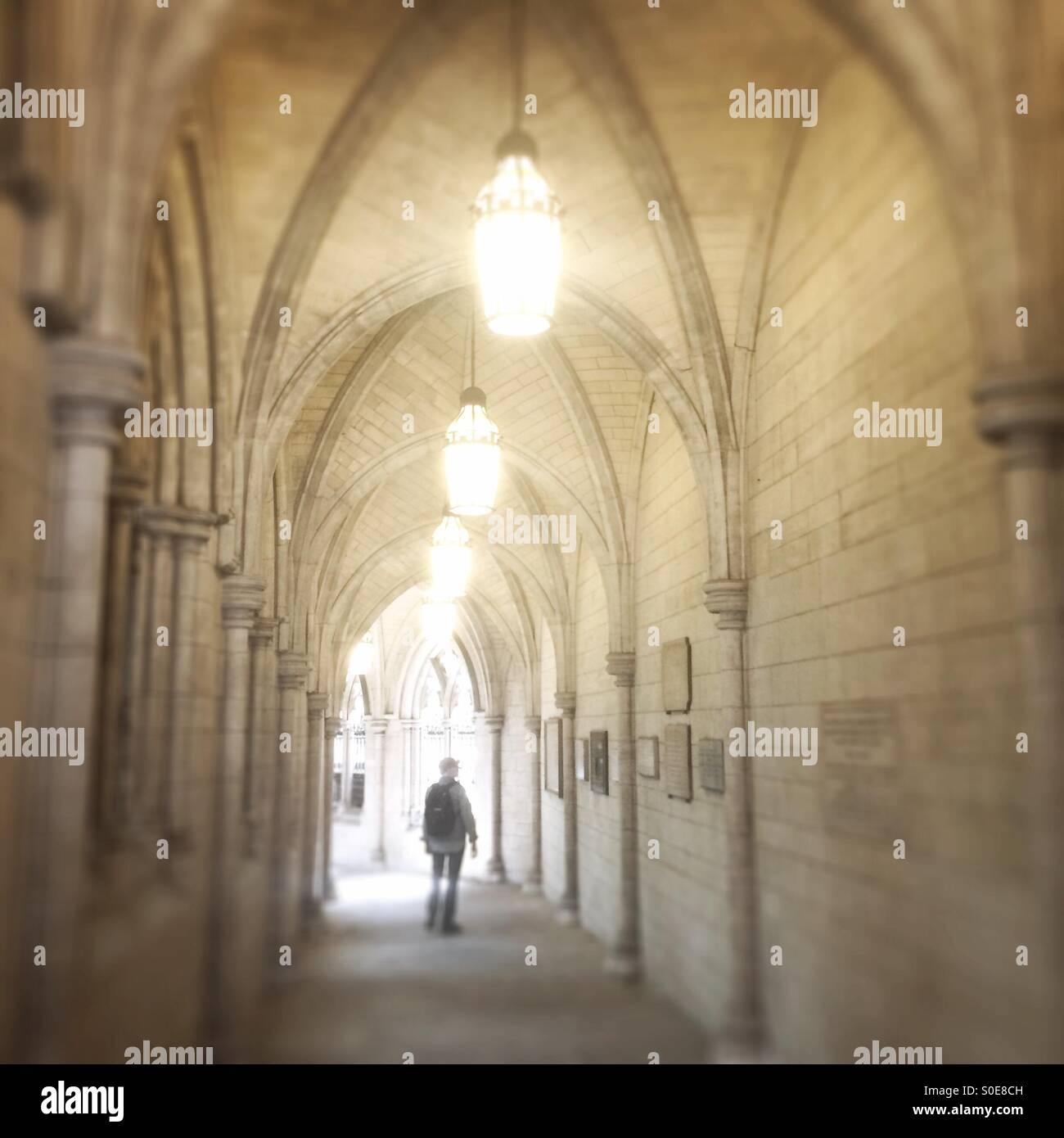 Man in passageway in church, London - Stock Image