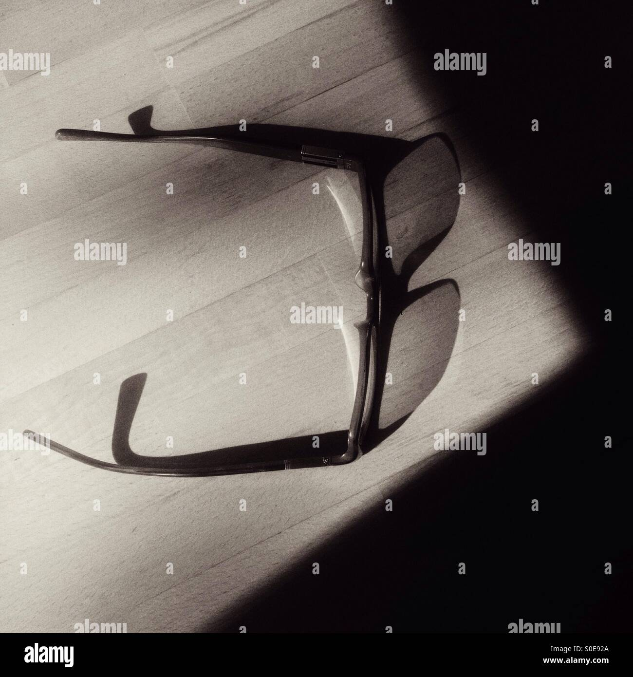 Glasses or spectacles and shadow - Stock Image