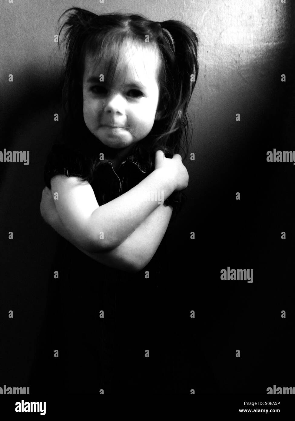 3-year old girl with pigtails in her hair - Stock Image