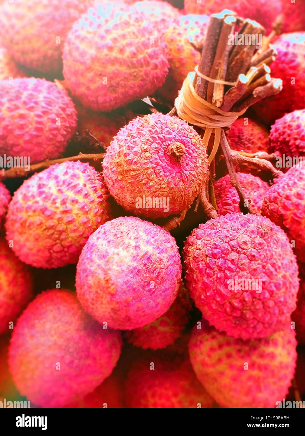 Lychees in outdoor stall Chinatown - Stock Image