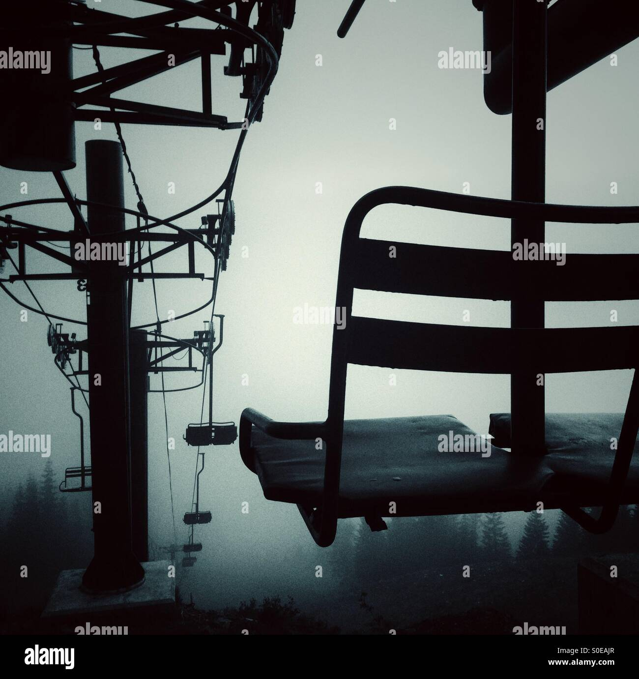 empty chair lift empty ski lift chairs in the fog at snoqualmie pass stock photo