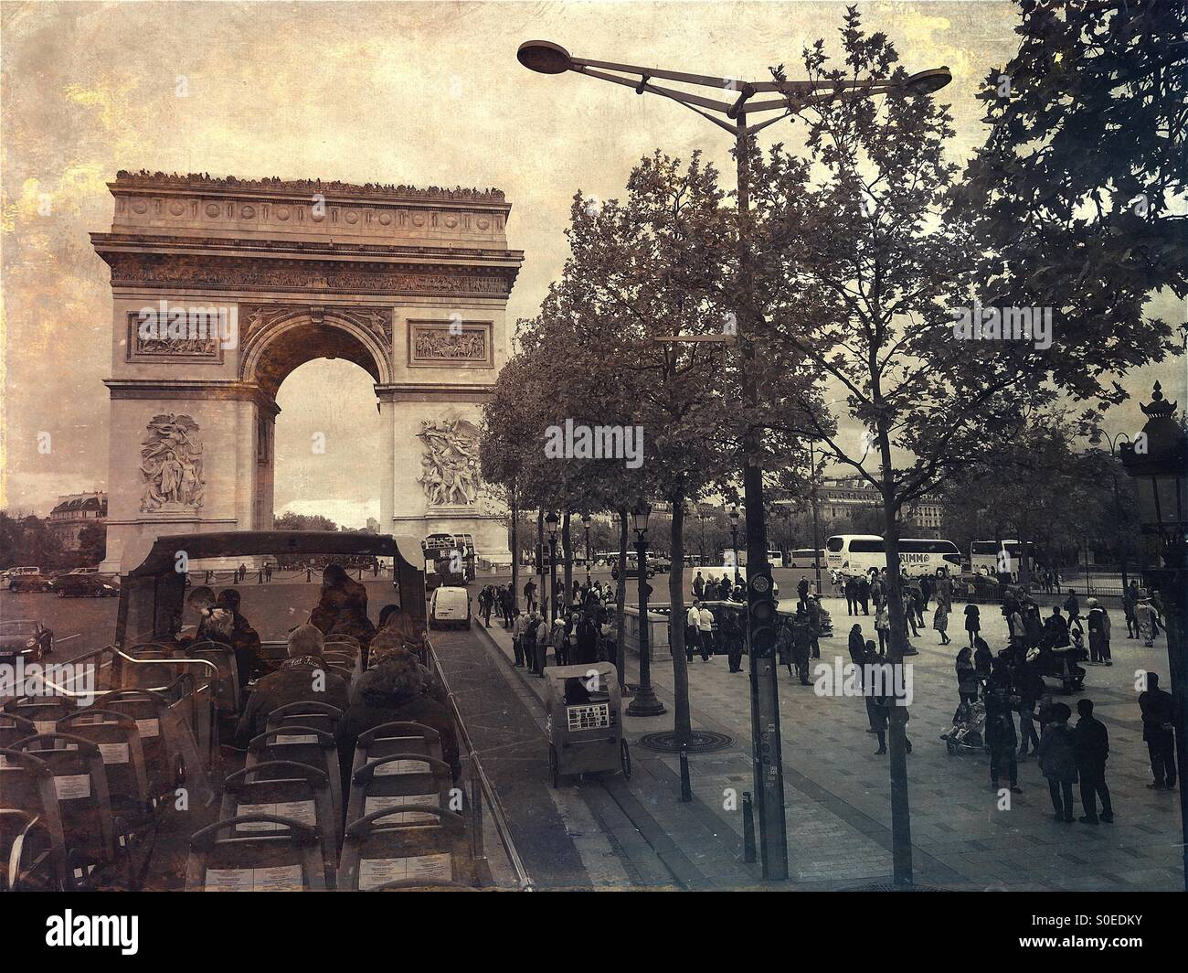 View of Arc de Triomphe from open air sightseeing bus on Avenue de la Grande Armée in centre of Place Charles de Stock Photo