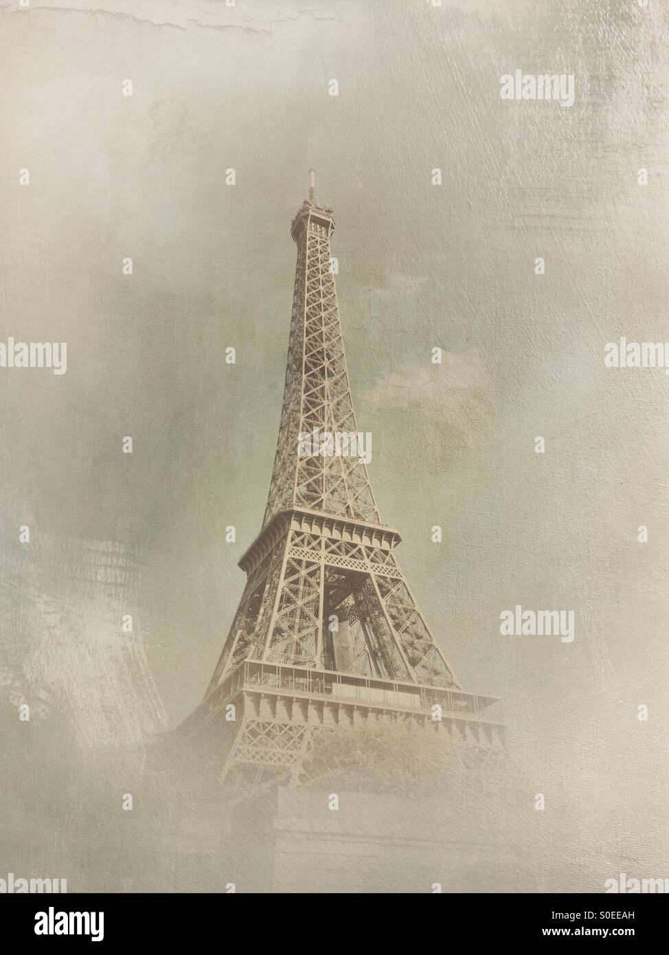 View of Eiffel Tower from cruise boat on Seine River in Paris, France. Vintage texture overlay. Stock Photo