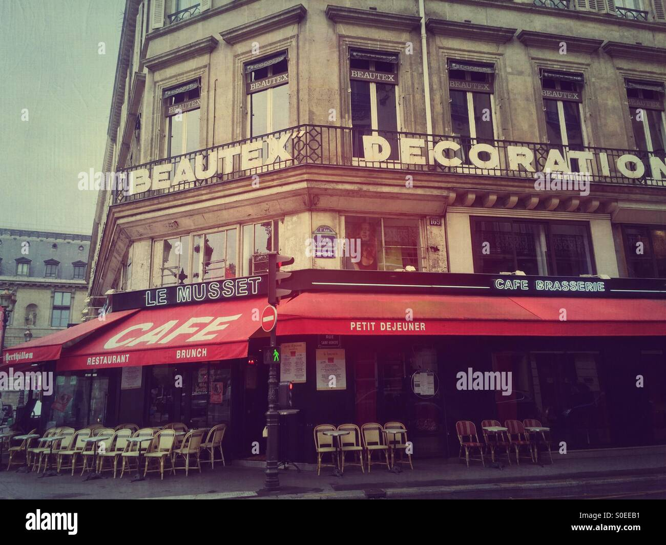 Le Musset cafe and brasserie on 1st arrondissement or district in central Paris, France. Vintage texture overlay.Stock Photo