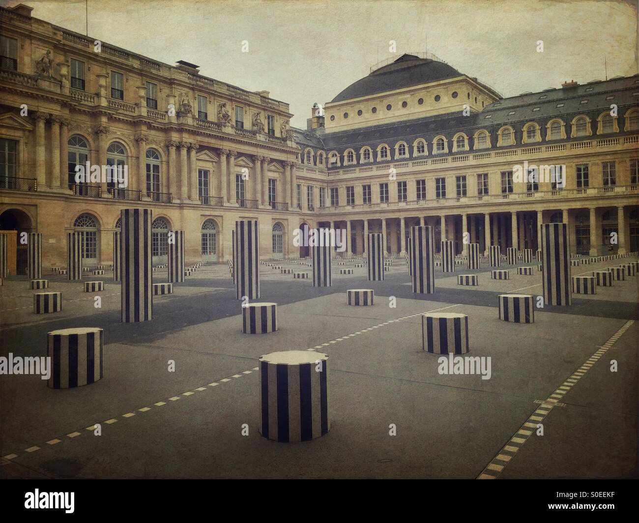 View of main courtyard at Place du Palais-Royal in Paris, France. Les Deux Plateaux installation by Daniel BurenStock Photo