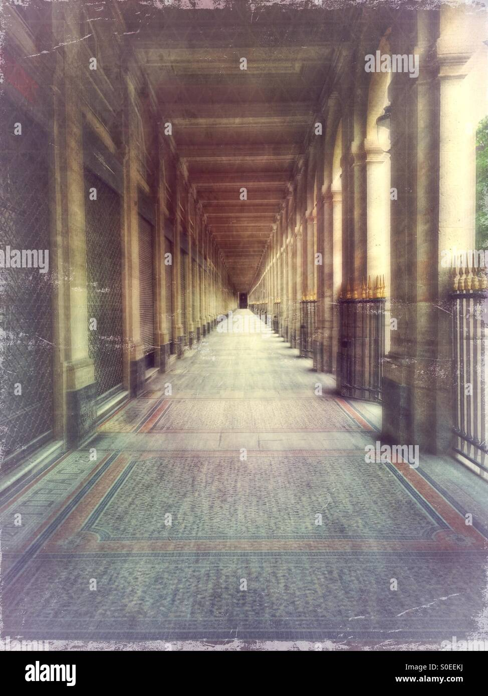 Arcade of Valois Gallery at Palais-Royal early in the morning. 1st arrondissement or district in central Paris,Stock Photo