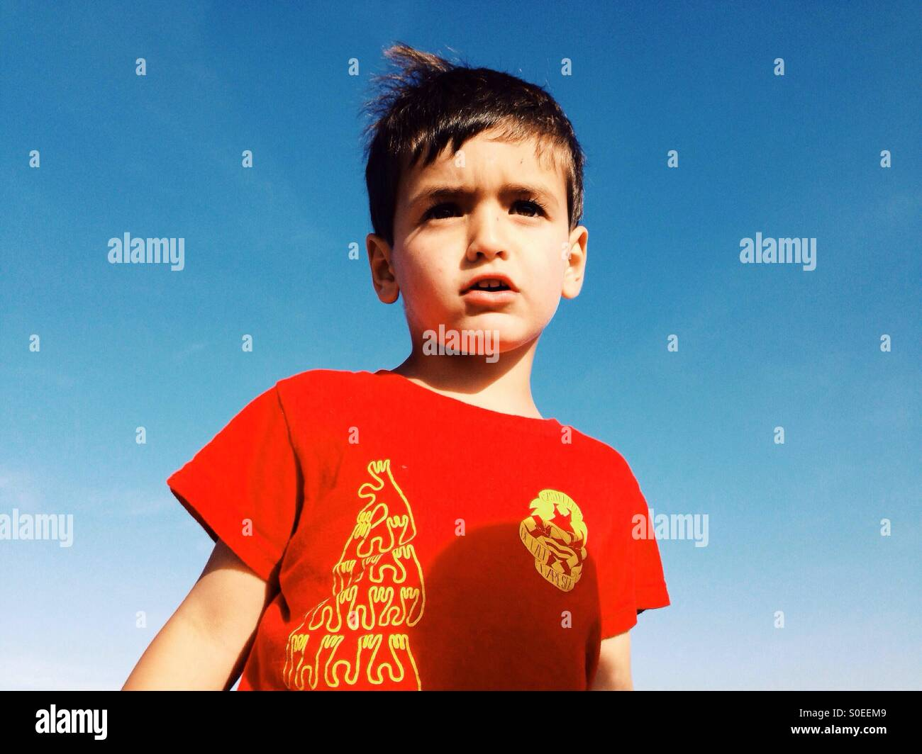Three years old boy in a red t-shirt - Stock Image
