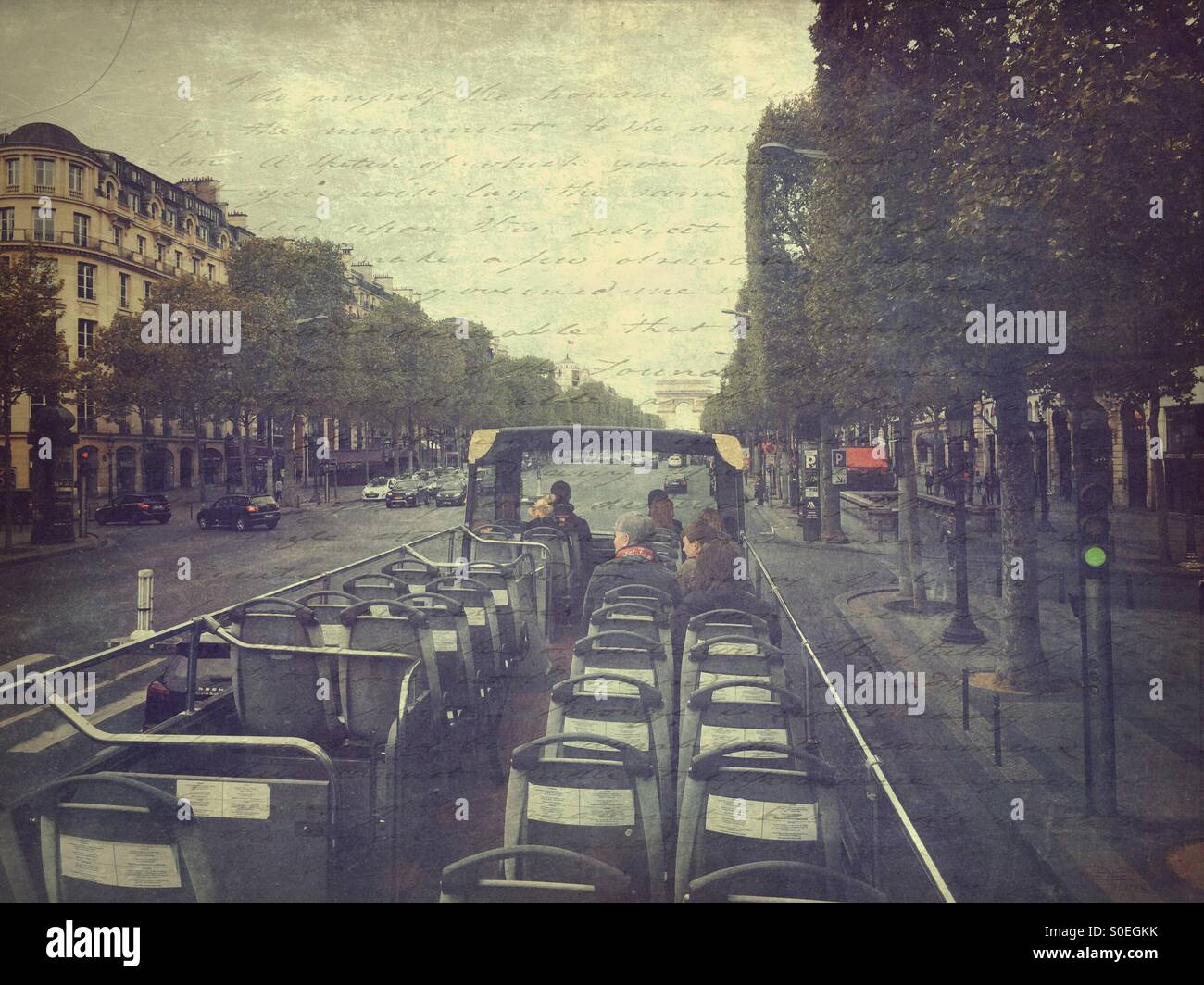 View of Champs Elysees from roof of open air sightseeing bus in Paris, France. Vintage paper texture with lettering Stock Photo