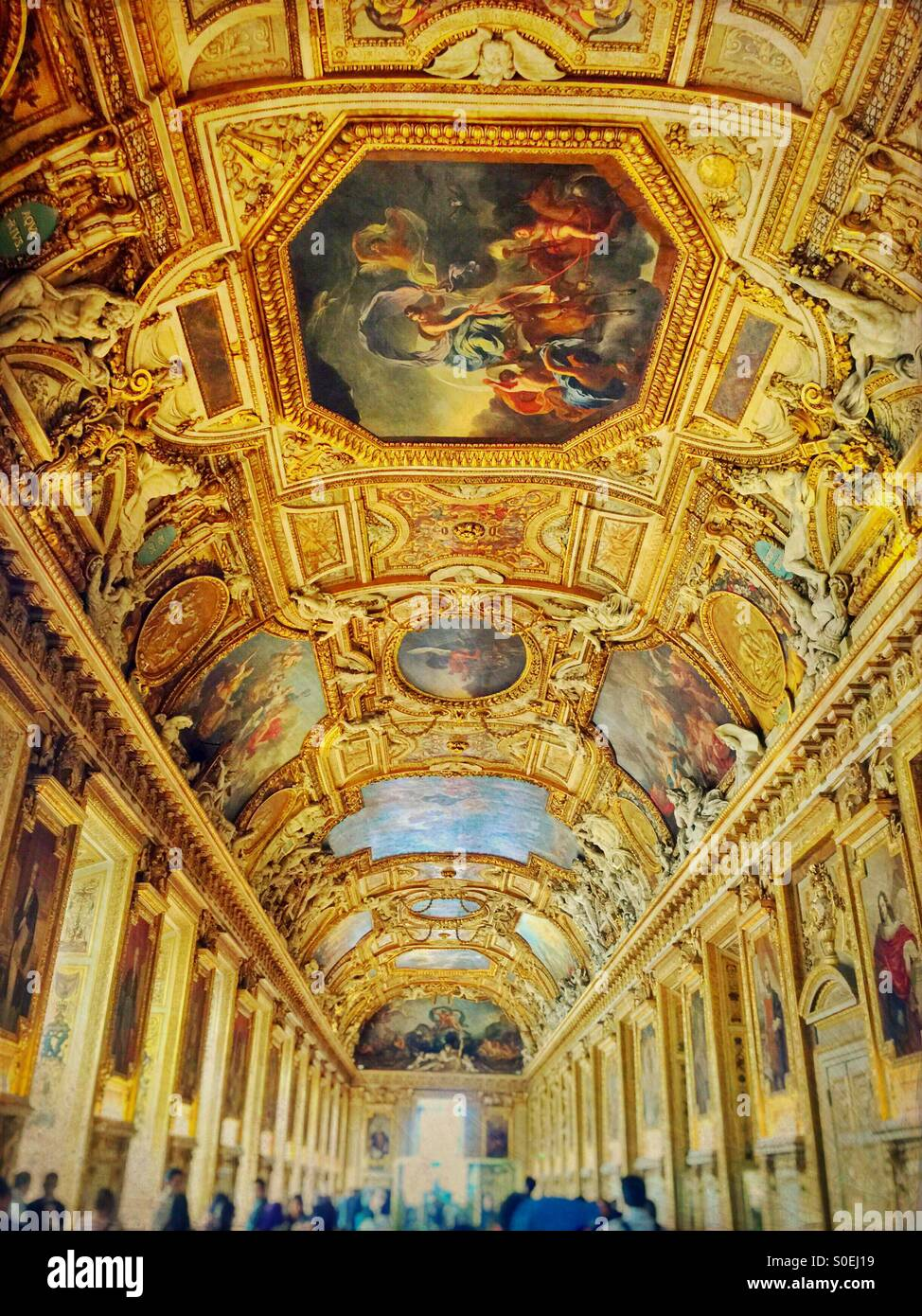 The golden Galerie d'Apollon famous for its high vaulted ceilings with painted decorations and stucco sculptures.Stock Photo