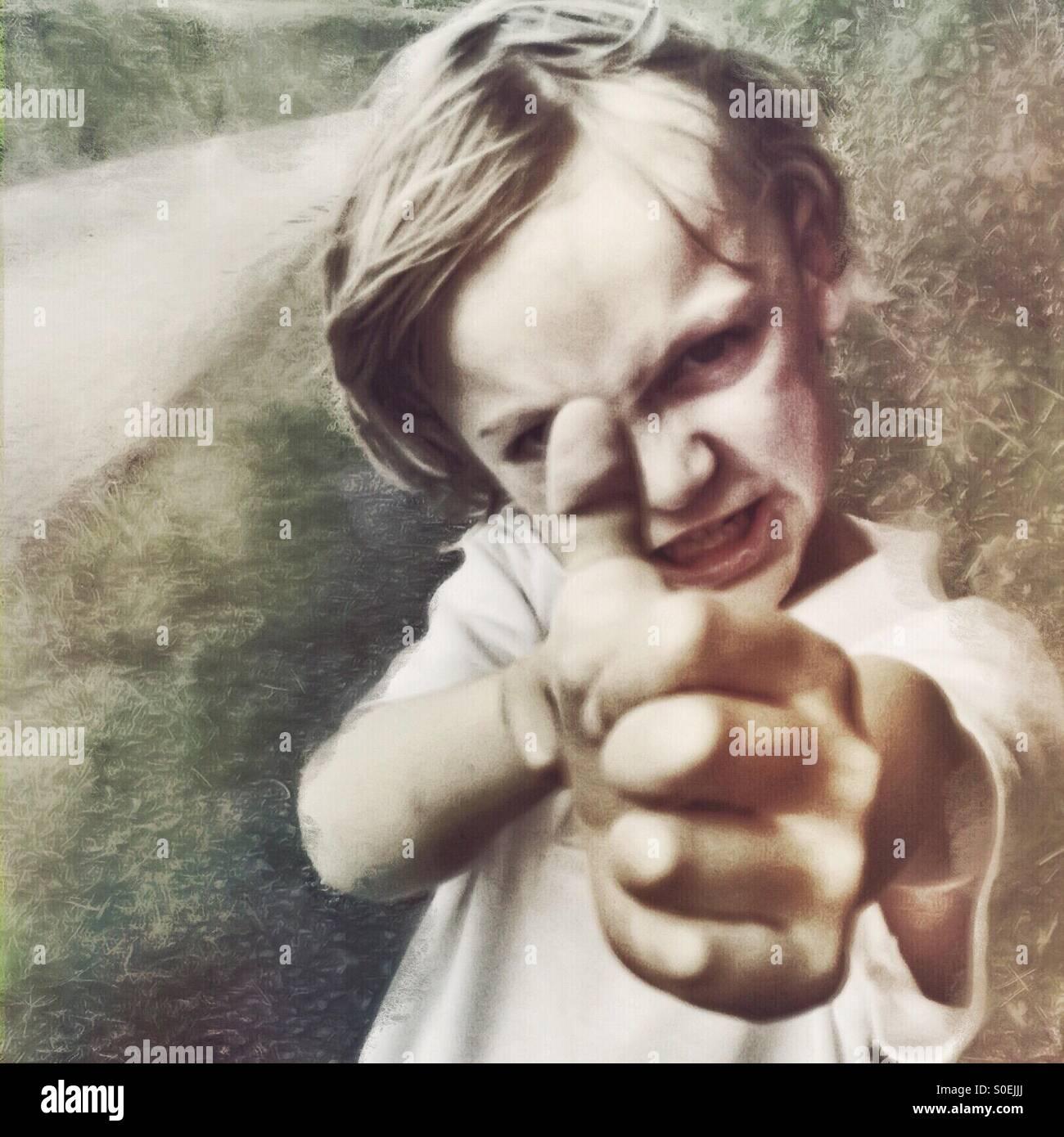 Boy taking aim - Stock Image