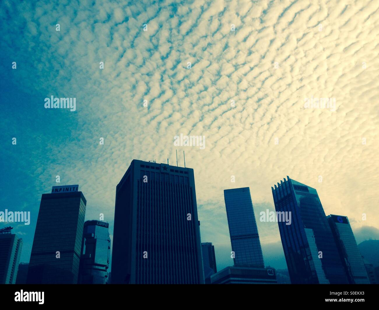 Cloud formation over metropolis - Stock Image