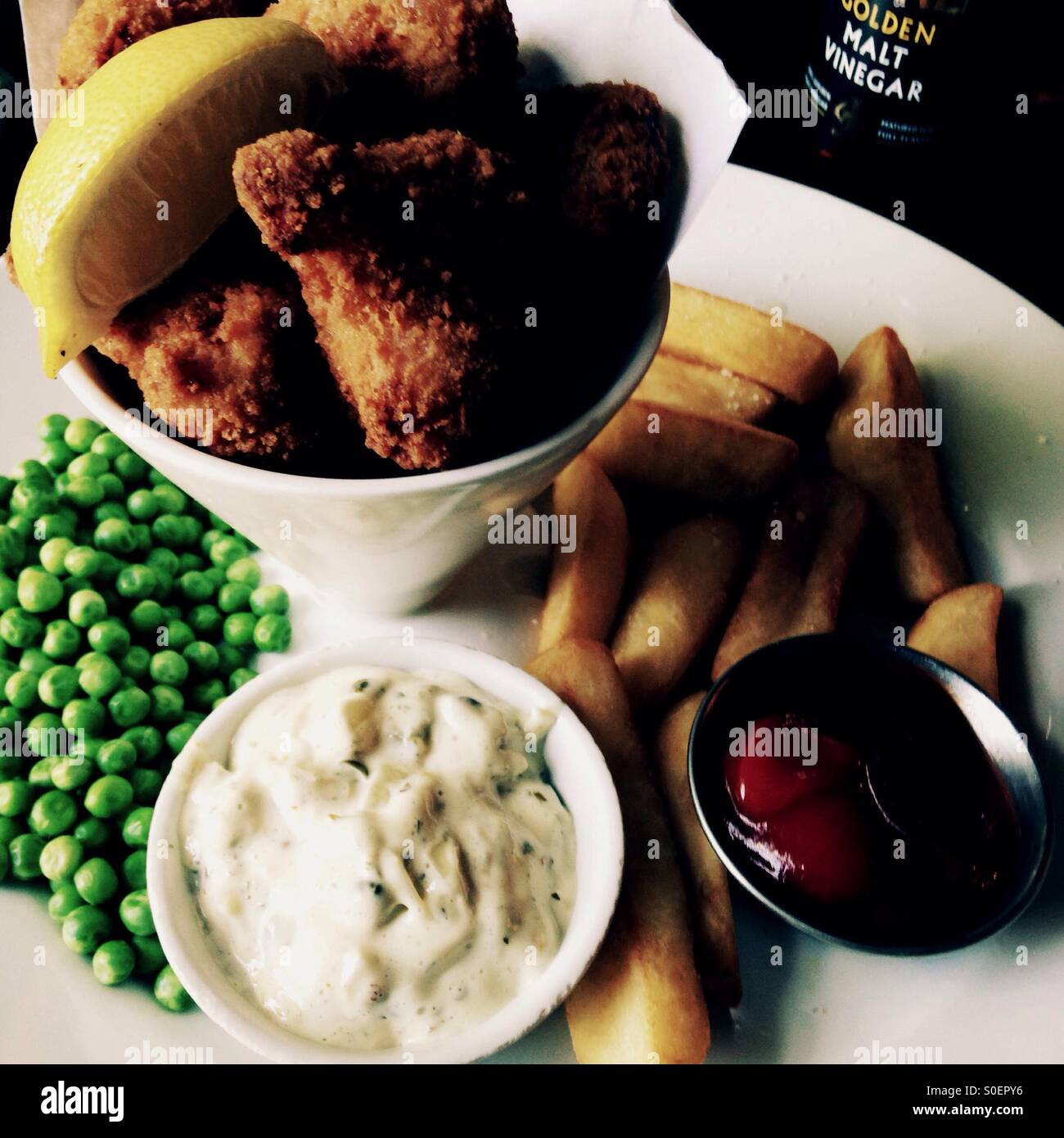 Scampi, chips and peas Stock Photo