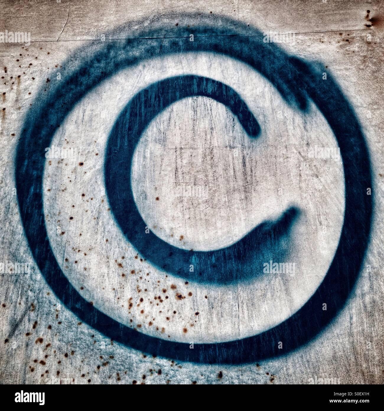 Copyright Symbol c Graffiti on a Billboard - Stock Image