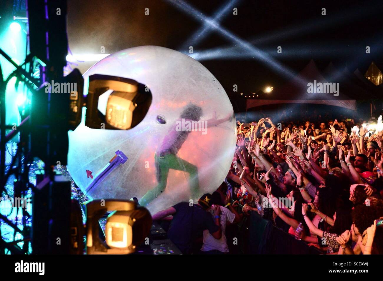 The Flaming Lips' Wayne Coyne heads out into the crowd in his signature  'hamster ball' during the Levitation - Stock Image