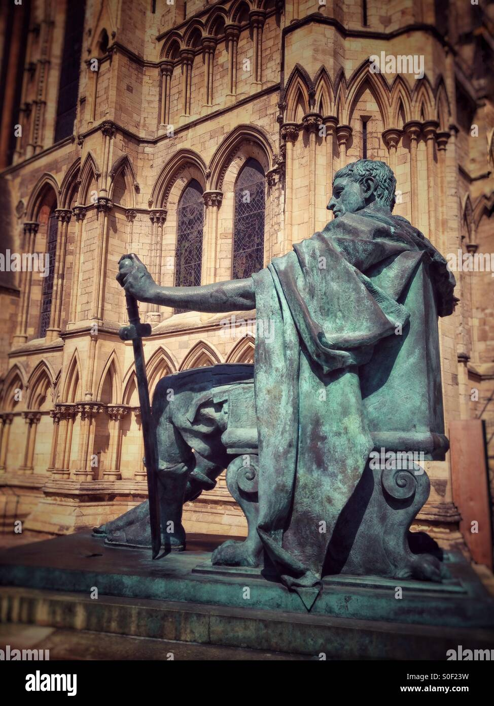 Emperor Constantine statue outside a sunlit York Minster, Yorkshire England UK - Stock Image