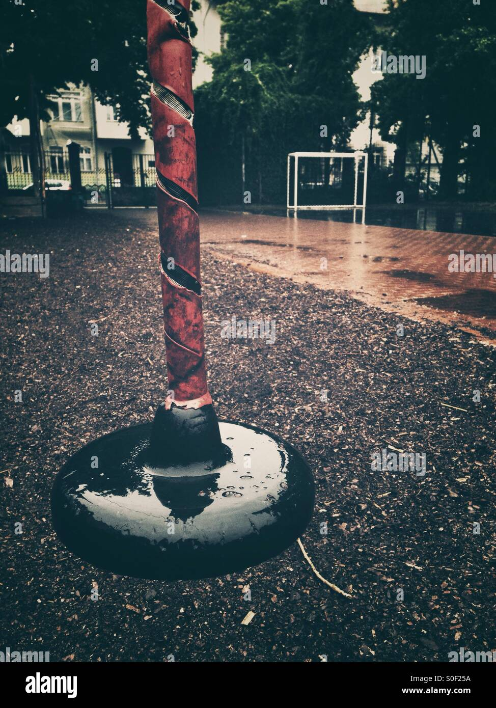 A deserted Playground in the Rain - Stock Image