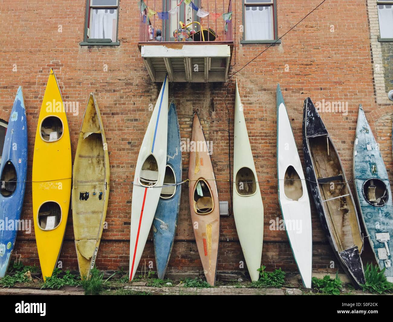 Kayaks in a row - Stock Image