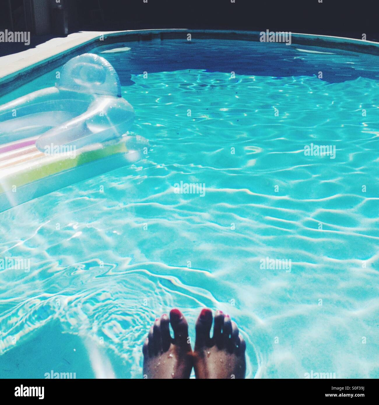 Toes in pool - Stock Image