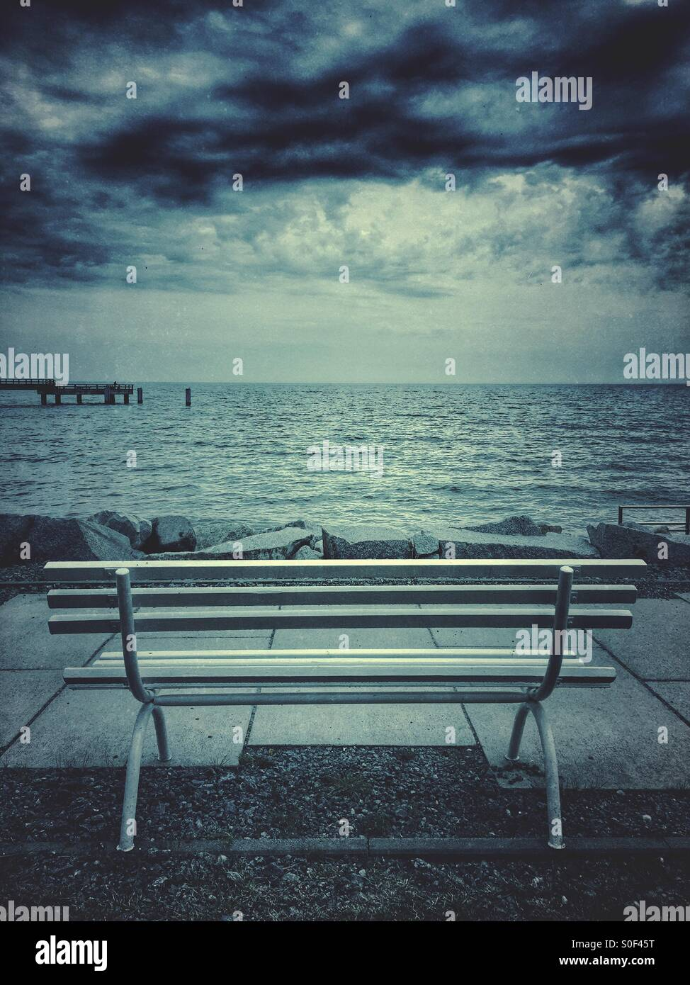 Empty bench by the Baltic Sea - Stock Image