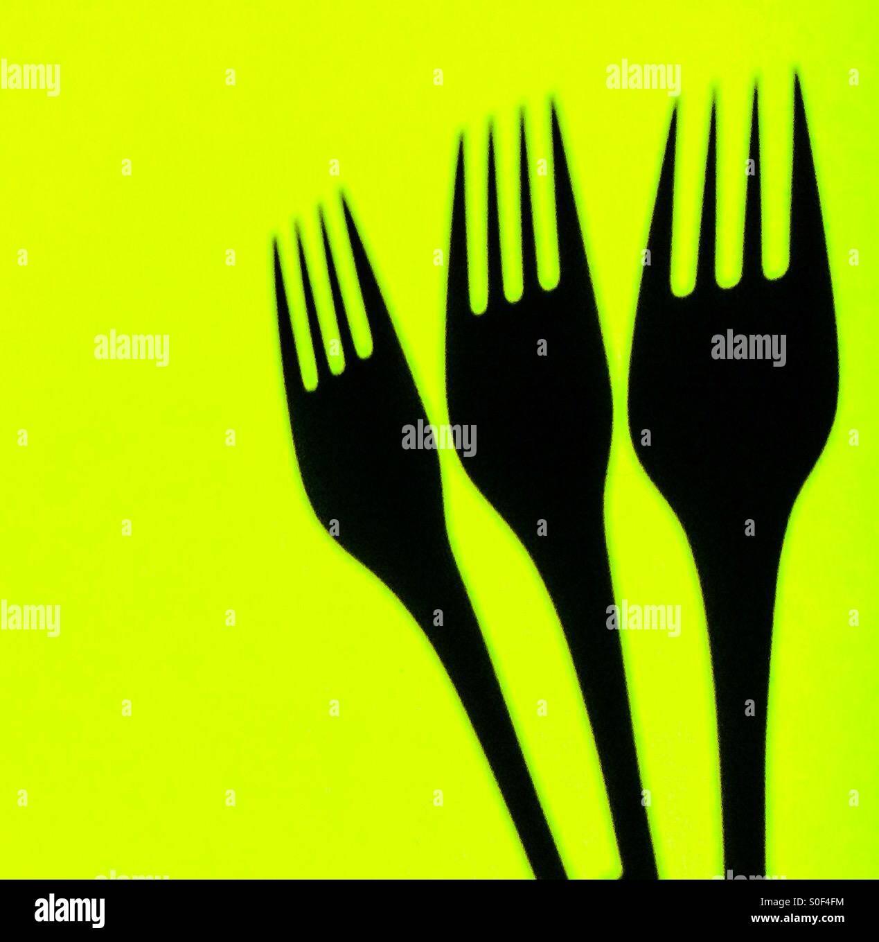 Forks on vivid background - Stock Image