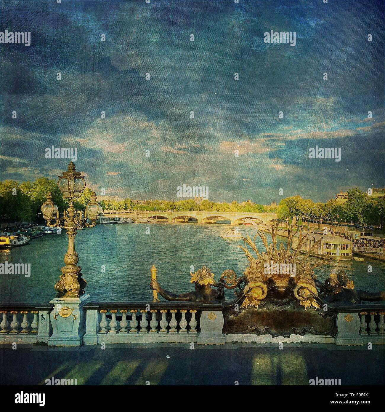 View of the Seine River from Pont Alexandre III, regarded as the most ornate, extravagant bridge in Paris. FrenchStock Photo