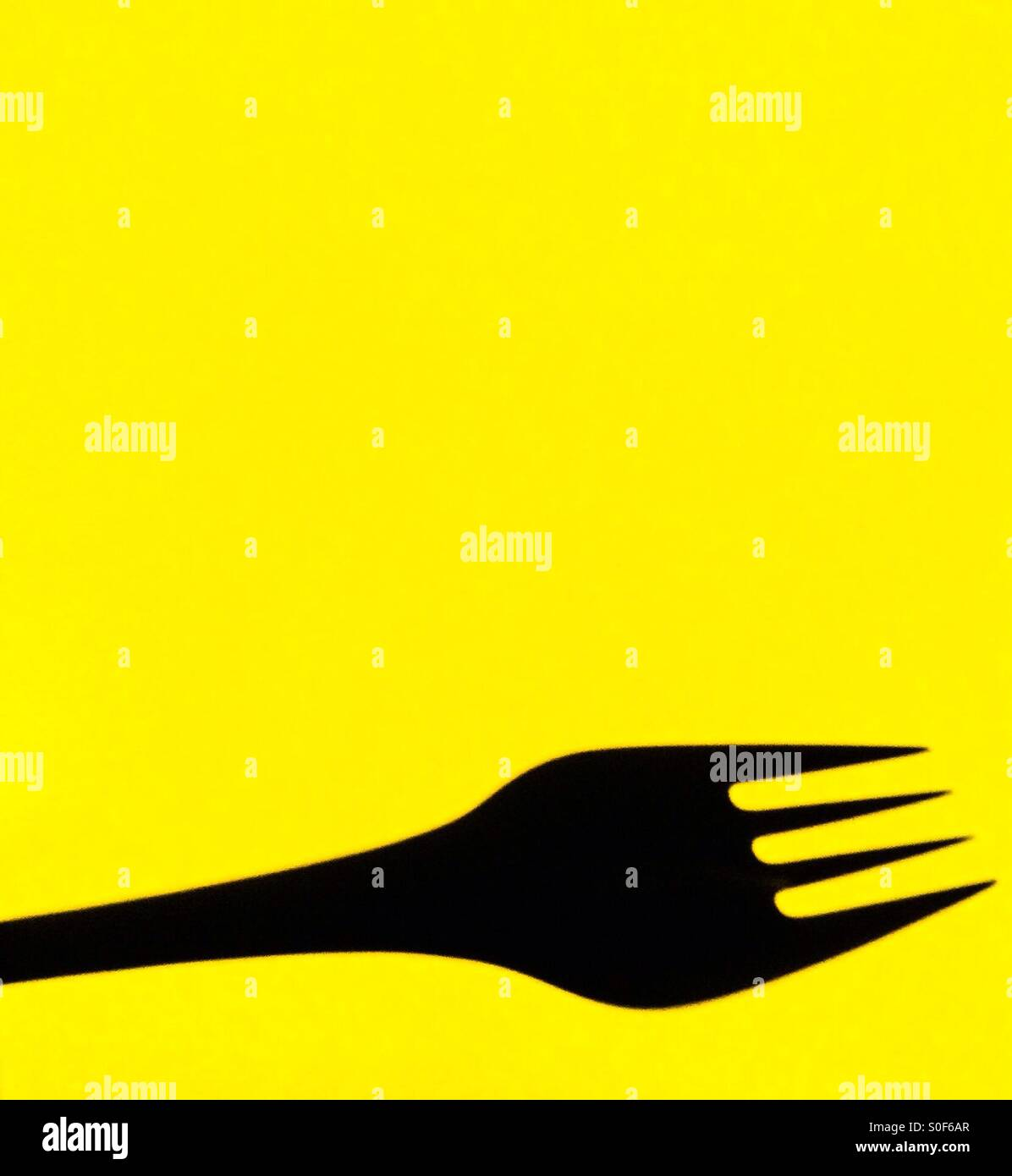 Fork on yellow backgroundStock Photo