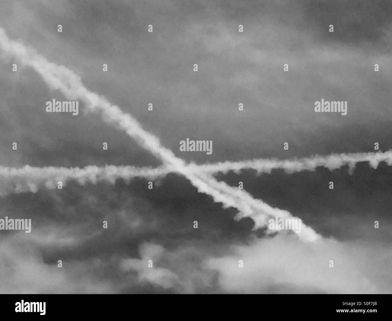 Airplane trails in the sky. - Stock Image