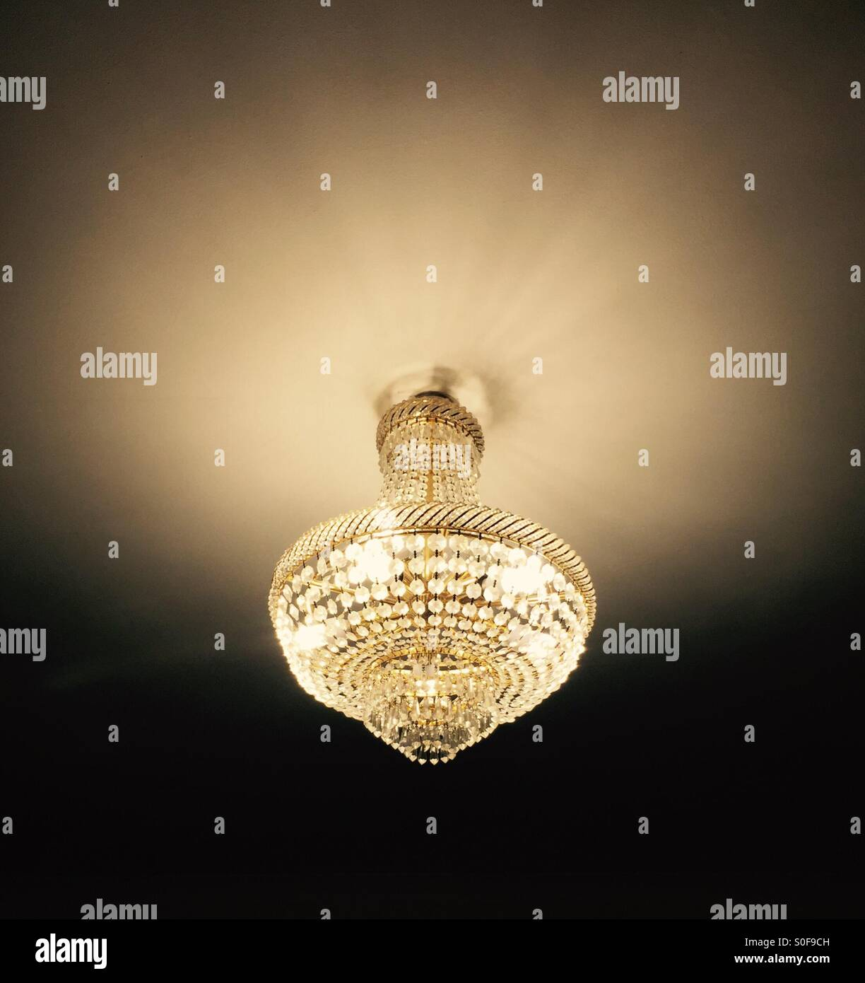A chandelier stock photos a chandelier stock images alamy golden light from a chandelier stock image mozeypictures Gallery