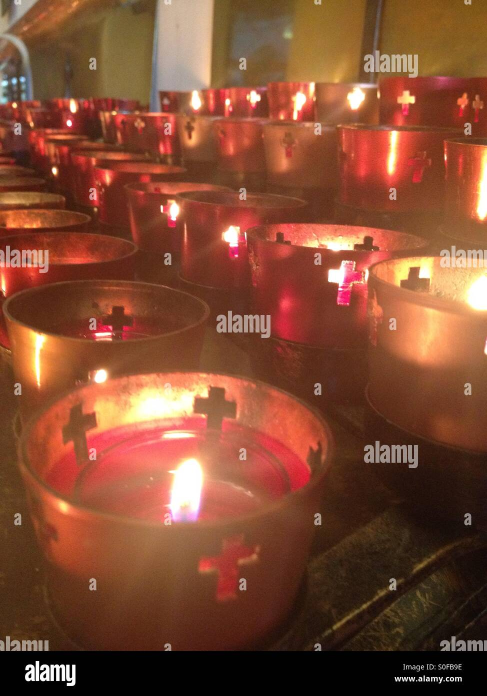candles at the shrine of mary queen of the universe in orlando stock