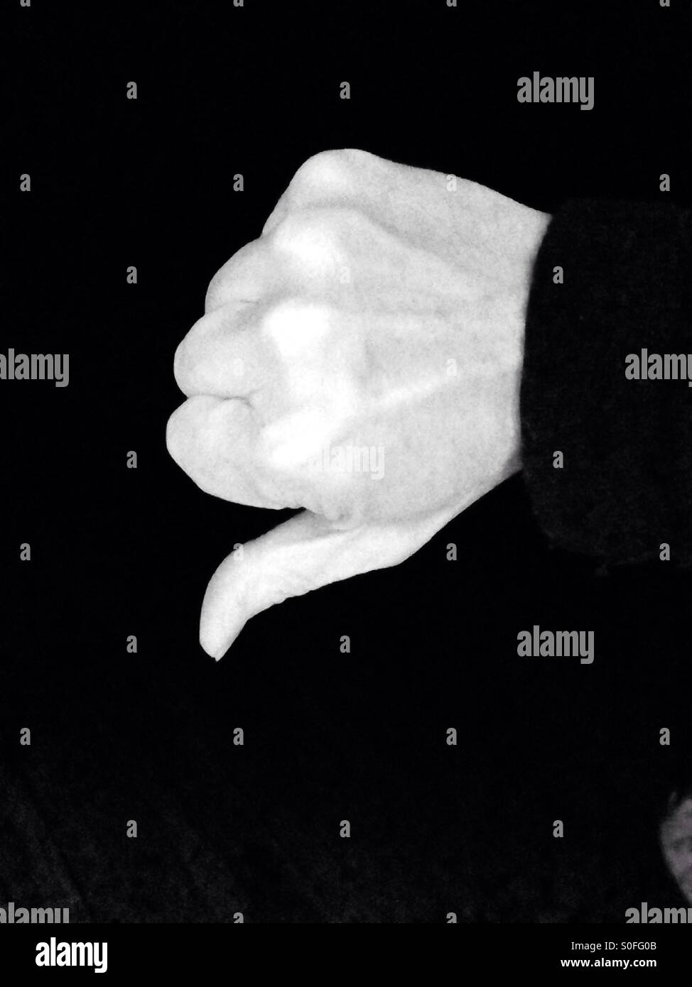 Thumbs down in black and white - Stock Image