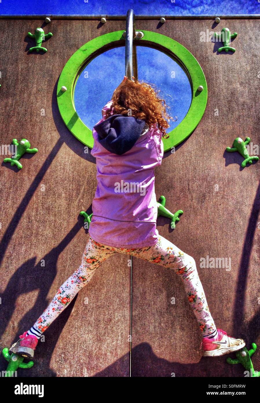 Young girl on climbing wall - Stock Image