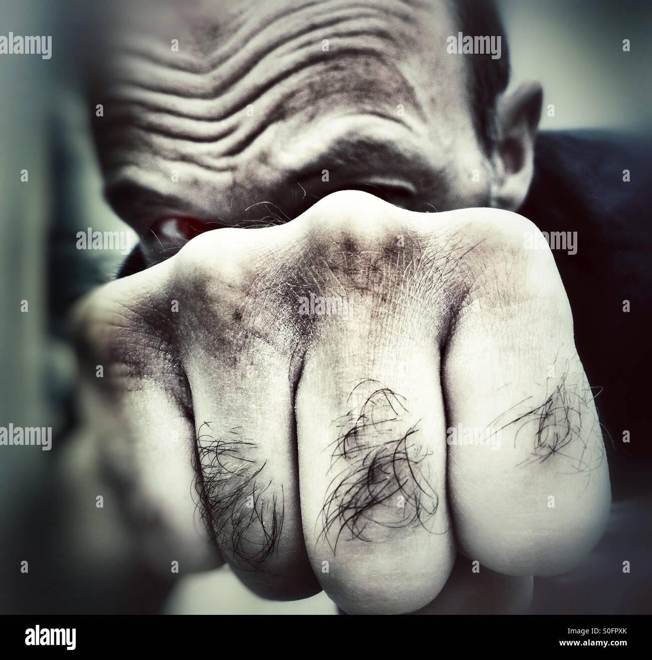 Man punching - Stock Image