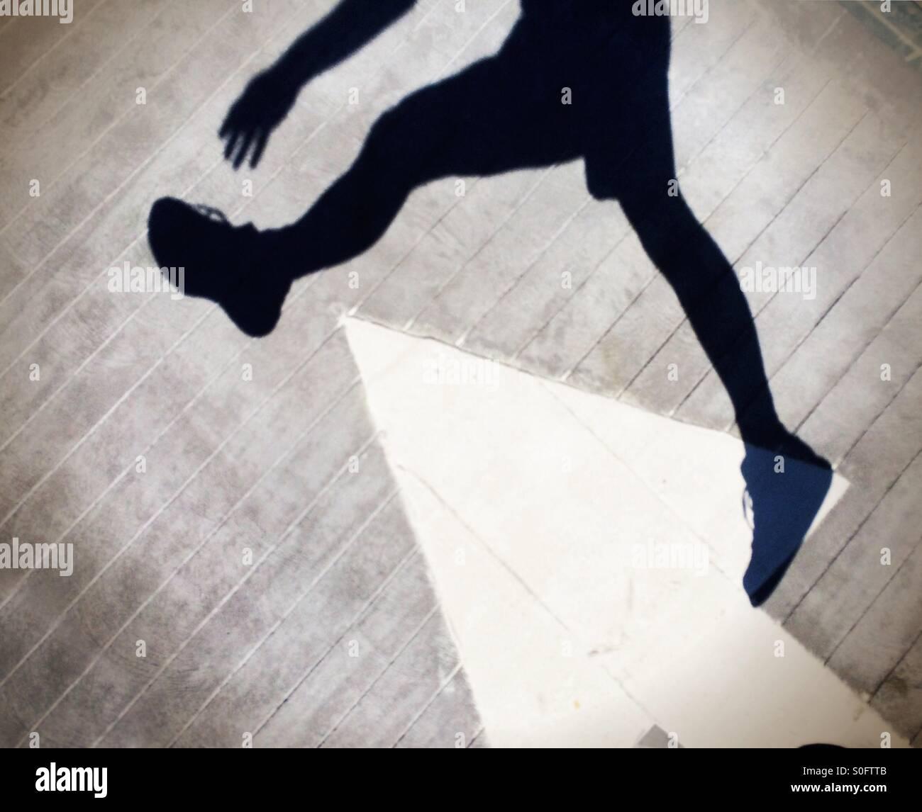 Man jumping over arrow Stock Photo