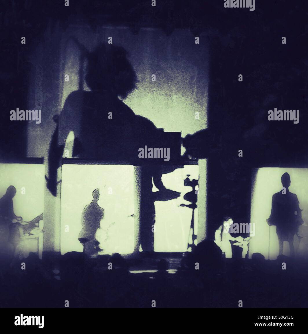 Shadow play on stage during a concert - Stock Image