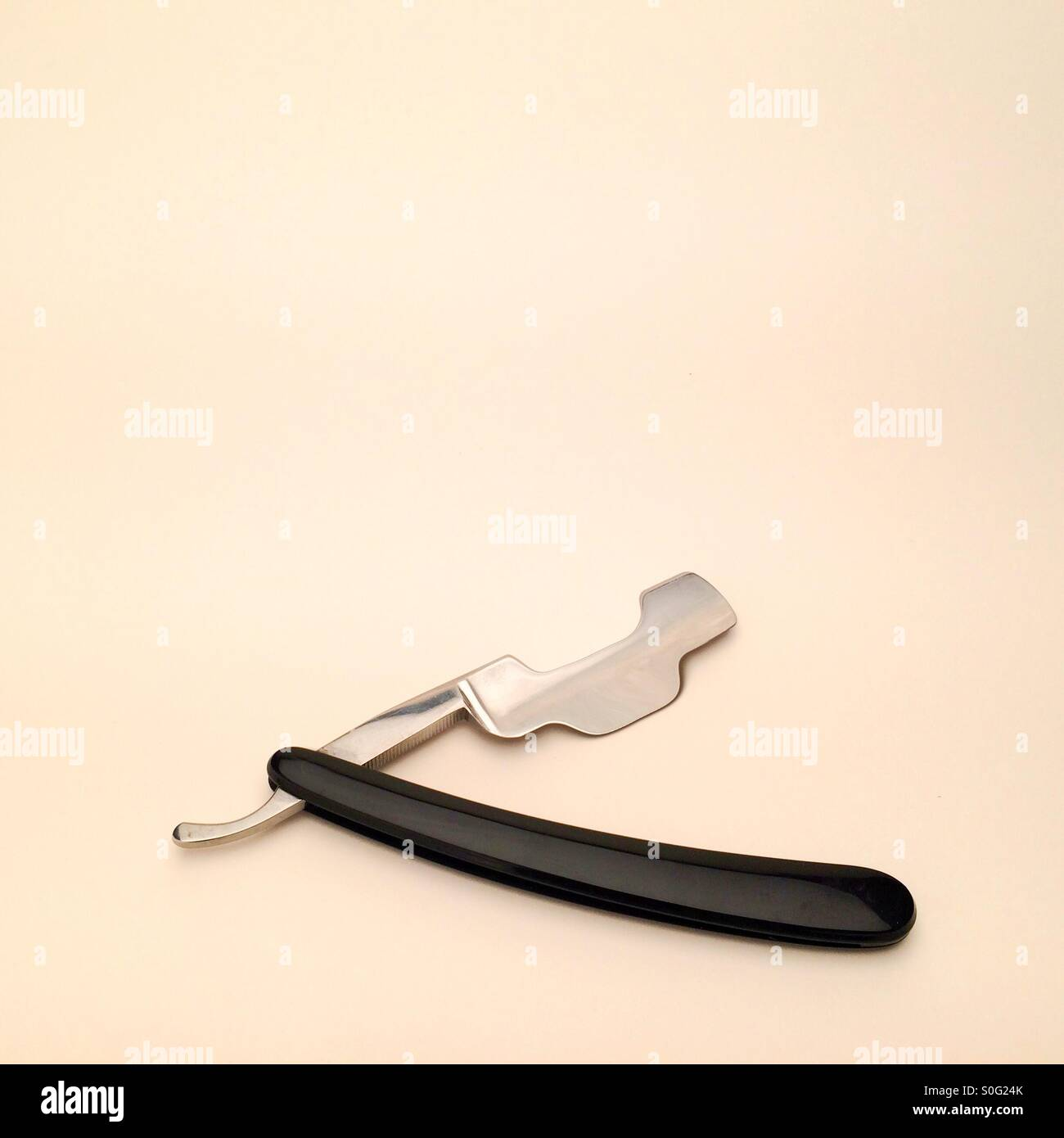 Artistic digitally altered image showing a futuristic fantasy steampunk strange and surreal shaped cut throat razor - Stock Image