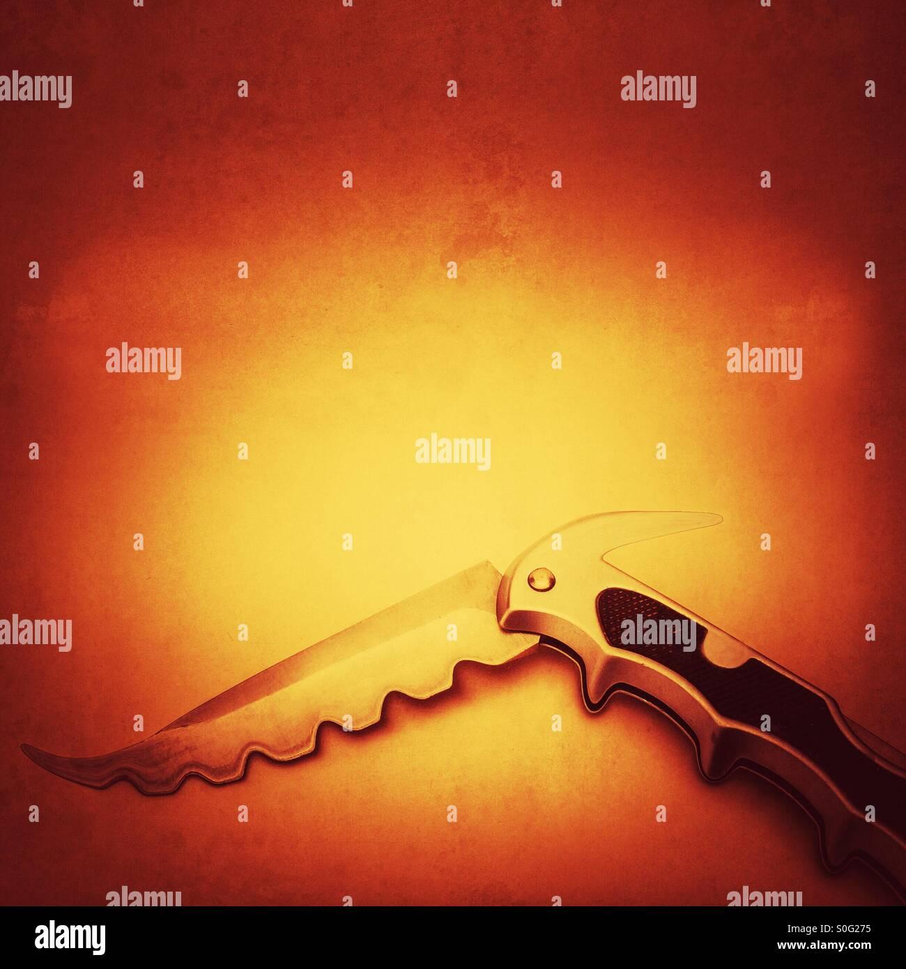 Savage looking pocket knife - Stock Image