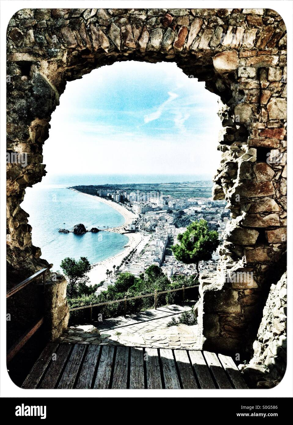 View of the beach of Blanes through a window Stock Photo